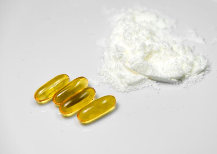 Wit collageenpoeder van zeevis extract en visolie pillen