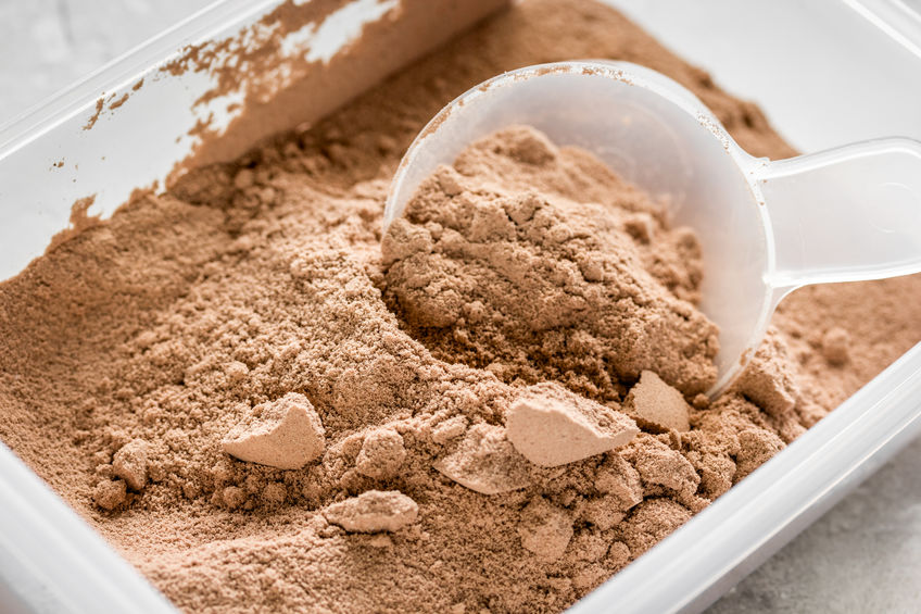 protein powder for fitness nutrition to start training stone background