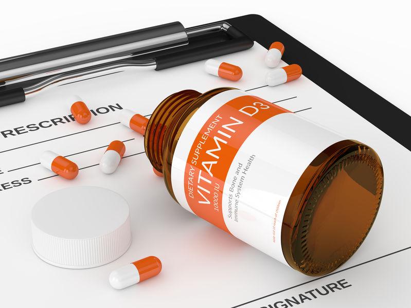 3d geef van vitamine d3 pillen terug in fles over klembord